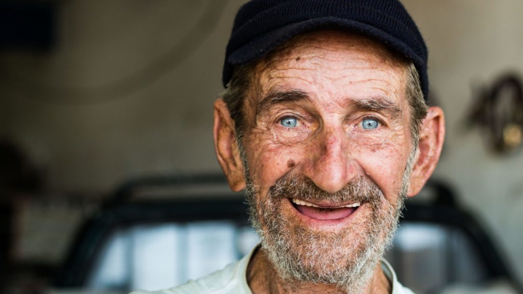 happy senior man with hat and whiskers