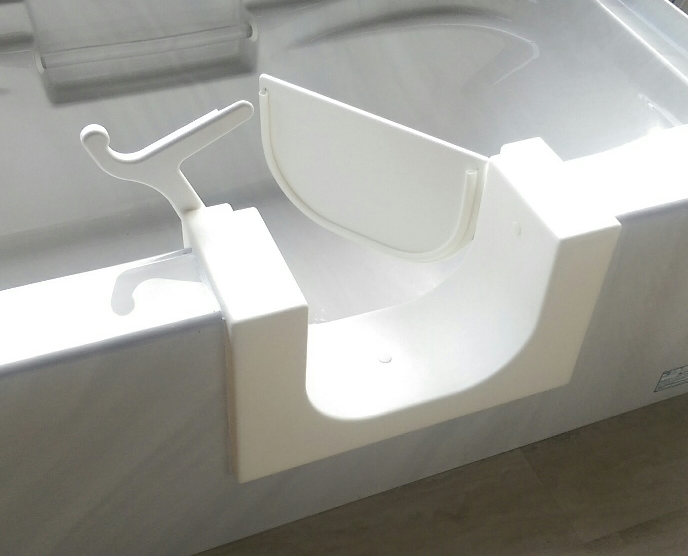 walk-in bathtub with door open, installed