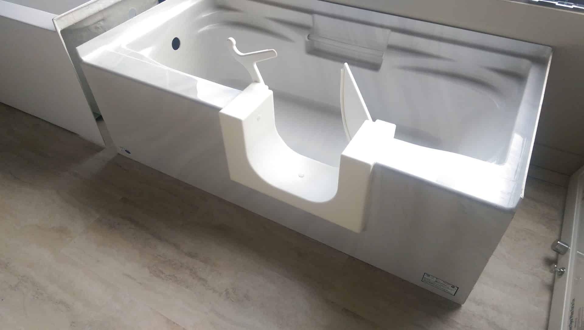 walk-in bathtub with door open, installed