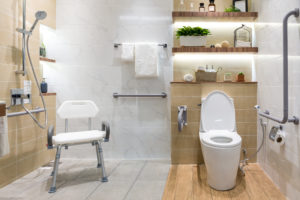 Safe bathroom for disabled or elderly. Handrails and shower chair for mobility challenged.
