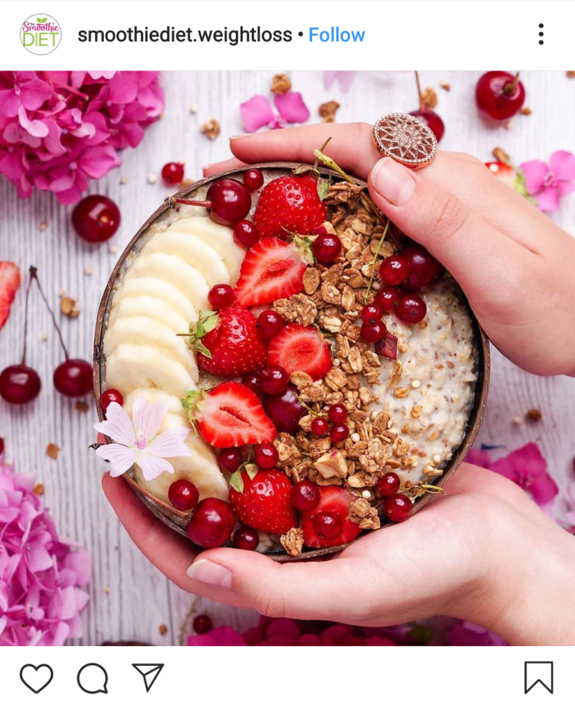 smoothie bowl with strawberries, bananas, cranberries, and more