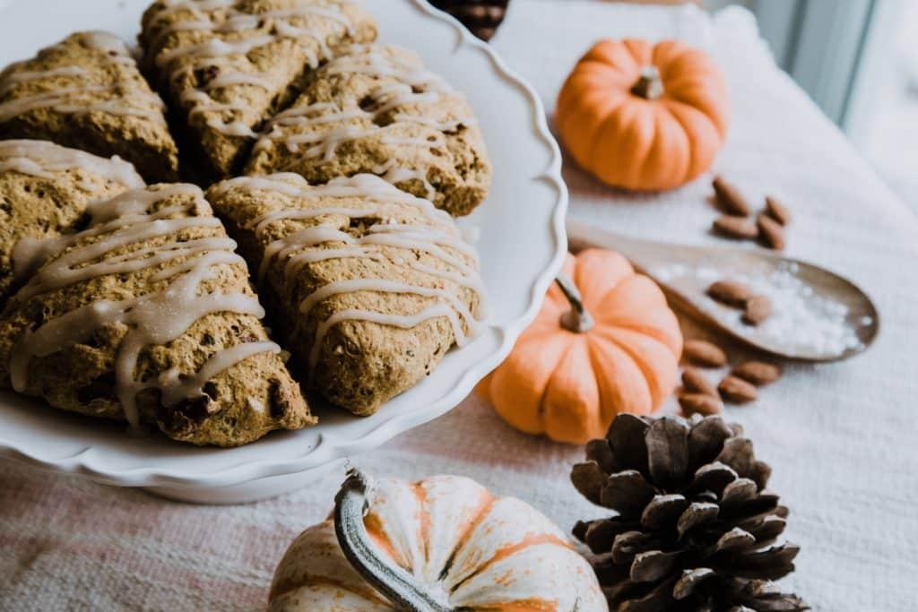 Fall arrangement of dessert and pumpkins