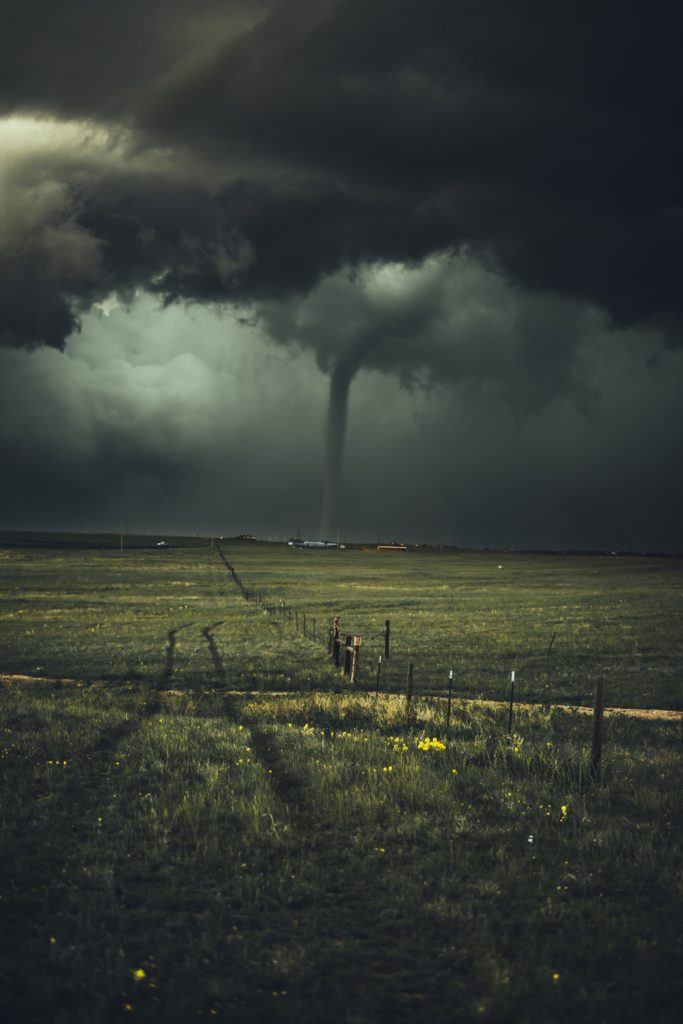Tornado on prairie field