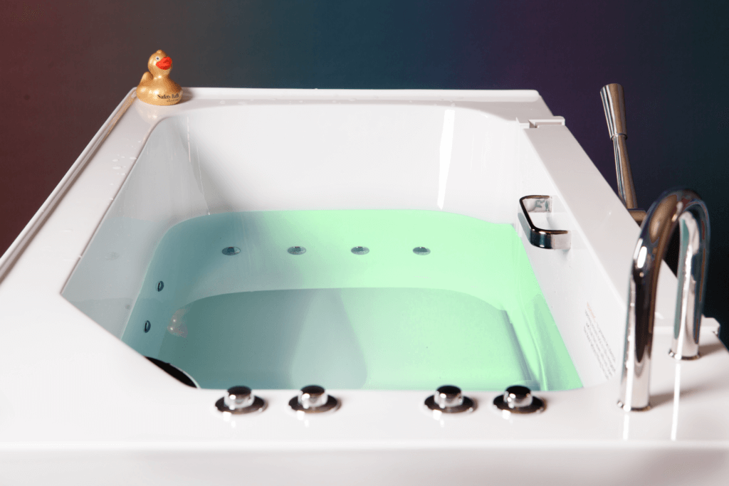 Squeaker sitting beside a safety Bath Walk-In Tub with chromatherapy lights