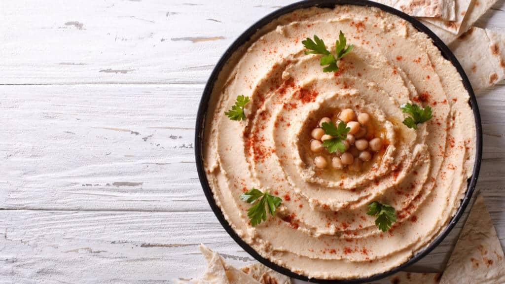A bowl of hummus.