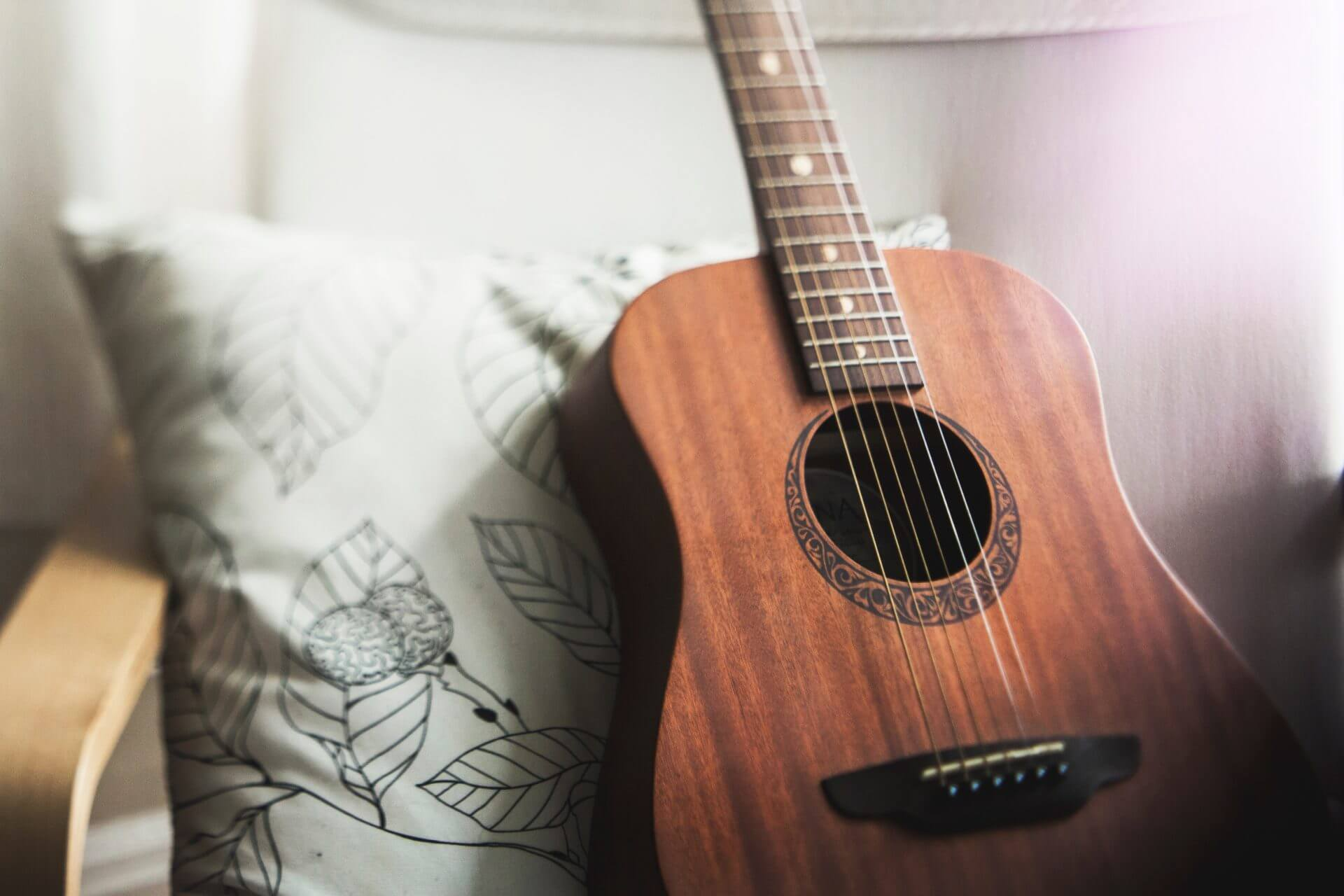 Guitar resting on pillow