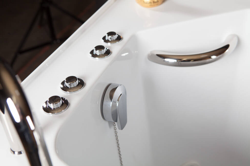 Closeup of a tub's drain system including chain,