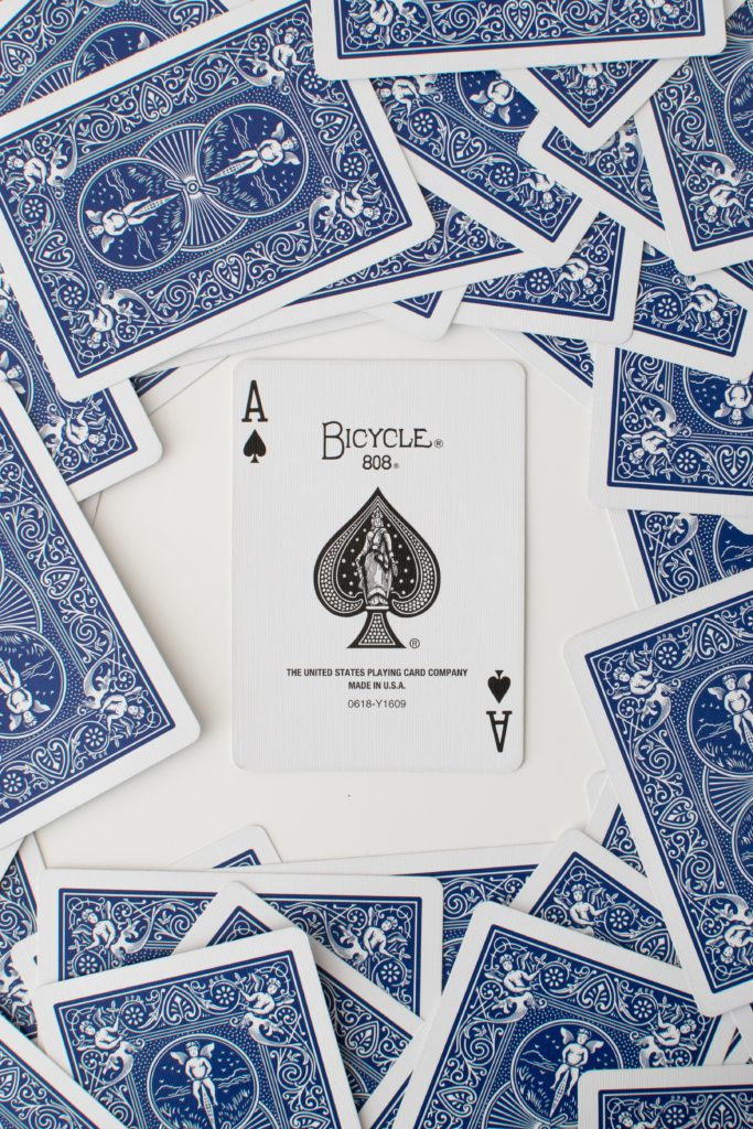 An Ace in the middle of a pile of cards
